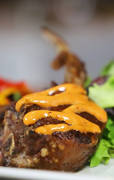 lambchop topped with sauce